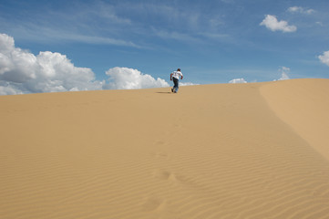 Person running on a sand dune in Venezuela