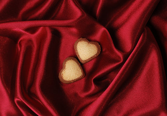 Sweet Hearts on Red Silk Background