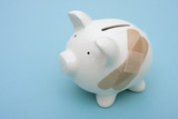 Piggy bank with adhesive bandage with copy space poster