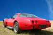 Vintage, red american sport car 70's on sky background