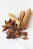 Star anise and cinnamon sticks, on a beige linen napkin. poster