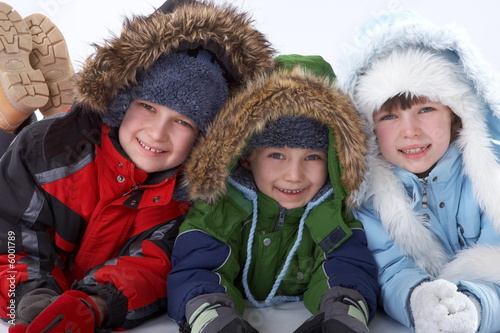 Happy children in jackets
