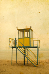 Lifeguard tower on vintage background