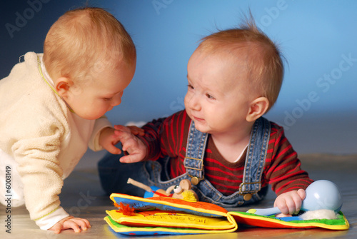 Babies playing with toys
