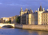 Palace Conciergerie riverside at overcast  sunset poster