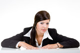 business women leaning on a desk poster