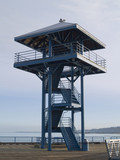 A lookout tower on a pier in the Pacific Northwest. poster
