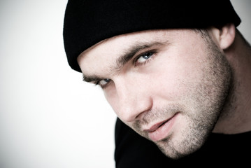 Portrait of young man wearing beanie.