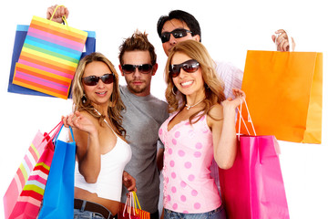 group of friends shopping and carrying bags looking very happy