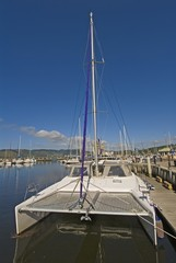 A twin Hull Yacht moored at the Knysna Yacht Club