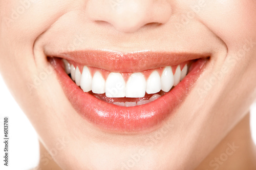 Beautiful young woman teeth. Isolated over  white background.