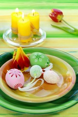Easter table setting - eggs, tulips and candle