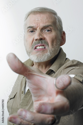 Angry man reaching out