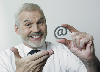 Smiling man with arobase sign