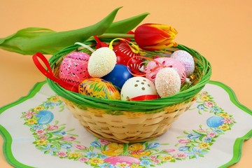 Basket full of easter decorations  - easter eggs and tulip