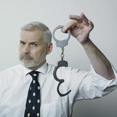 Man showing handcuffs