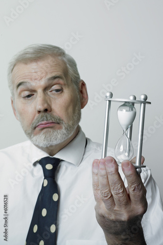 Perplexed man with hourglass