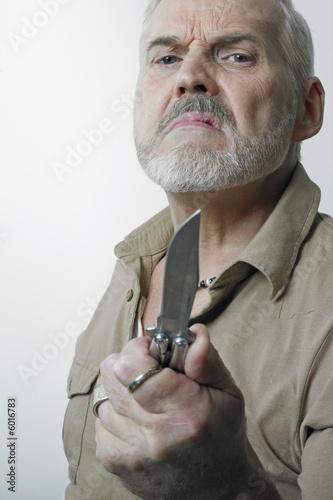 Matured man holding knife