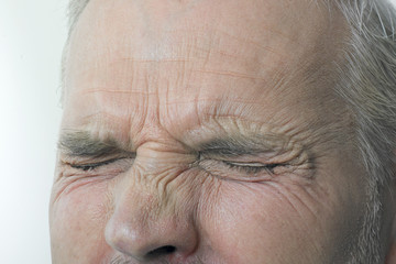 Man With Eyes Tightly Shut