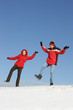 Yuong couple have fun on snow in winter