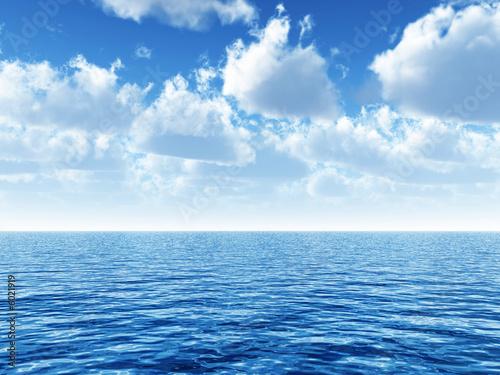 Leinwanddruck Bild cloudy blue sky above a blue surface of the sea