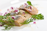 macro picture of herring fillet on the plate