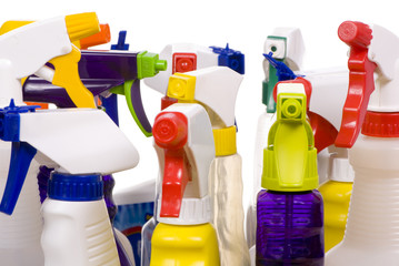 An assortment of different types of cleaning sprays.