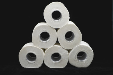 a lot of toilet papers on black background