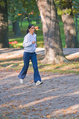 Image of a running girl in a park..