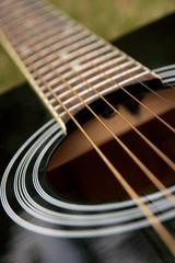 Black acoustic guitar, (shallow dof)