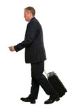 Businessman walking along pulling his travel luggage. poster