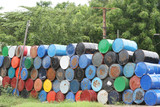 Stacks of colorful barrel once contained dangerous chemicals poster