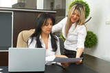 businesswomen working together at the office with a laptop poster