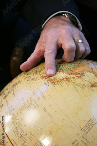 Business man hand pointing at Japan on Globe