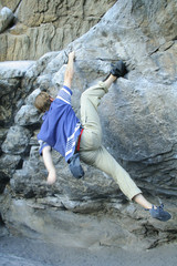 rock climber scalling a wall