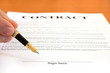 Hand pointing at signature place on a contract document