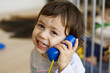 Child using toy phone - 6035940