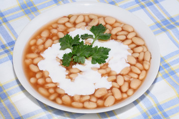 Plate with bean on the tablecloth