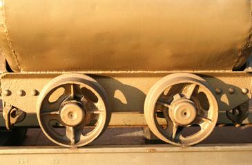 Mining cart wheels, welded to the rail tracks