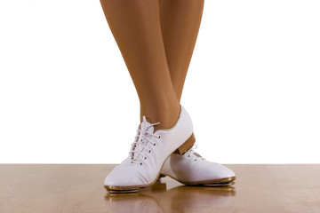 Tap-top/Clog dancer in clogging shoes; on white