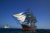Tall Sailing Ship at Sea under full sail  - 6041374