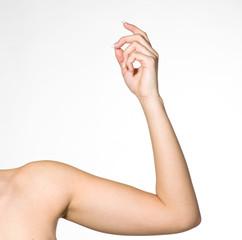 Arm von Frau schnippt mit Fingern