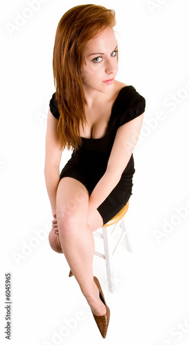 Sexy Redhead Lady Sitting on a Bench