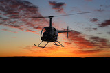 Helicopter Silhouette In Sunset