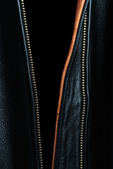 Open front of black leather jacket