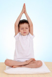 Fototapety 6 years old boy relaxing on blue background