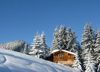 Pretty snow covered wood cabin in winter