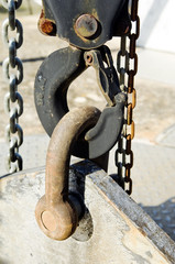 Industrial lifting hook with chains and beam