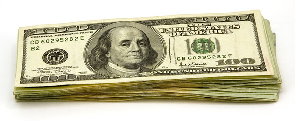 Stack of US Hundred Dollar Bills Isolated on White Background.