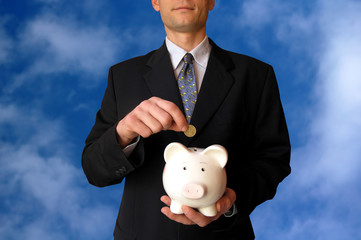 Businessman with a piggy bank